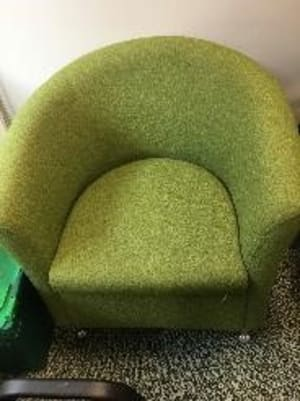 Green upholstered tub chair