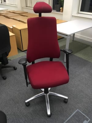 Office chair on wheels with headrest