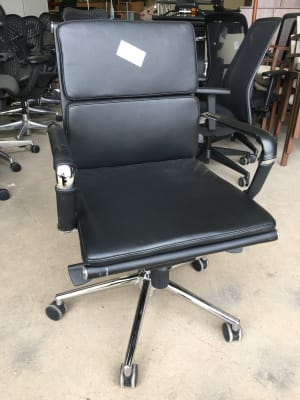 Leather office chair on wheels with chrome arms and frame