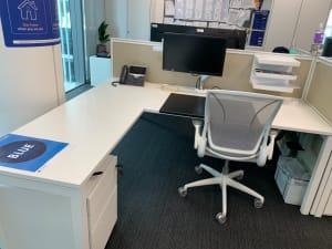 Bank of 2 White Senator desks with side extension and divider