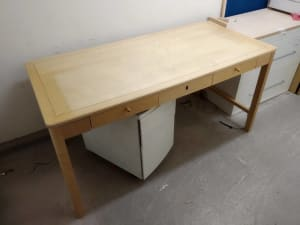 rectangular brown wooden table with three integral drawers