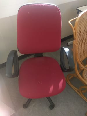 red and black swivel chair
