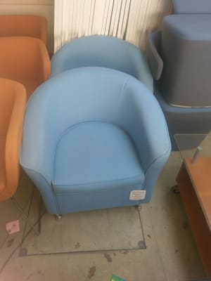 two blue tub chairs