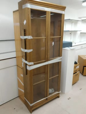 wooden display cabinet with glass panel doors