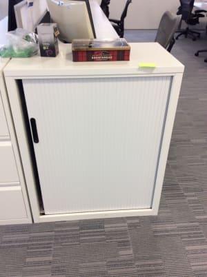 White metal tambour cabinet