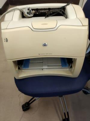 white HP 1200 printer