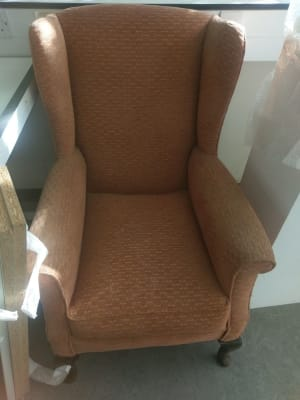 brown suede padded wing chair
