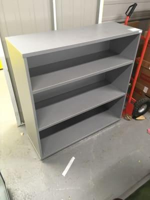 Grey wooden bookcase