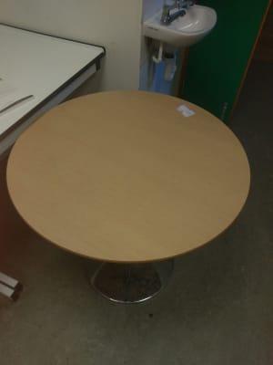 round beige wooden pedestal table