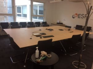 Boardroom table sits 18 seating positions