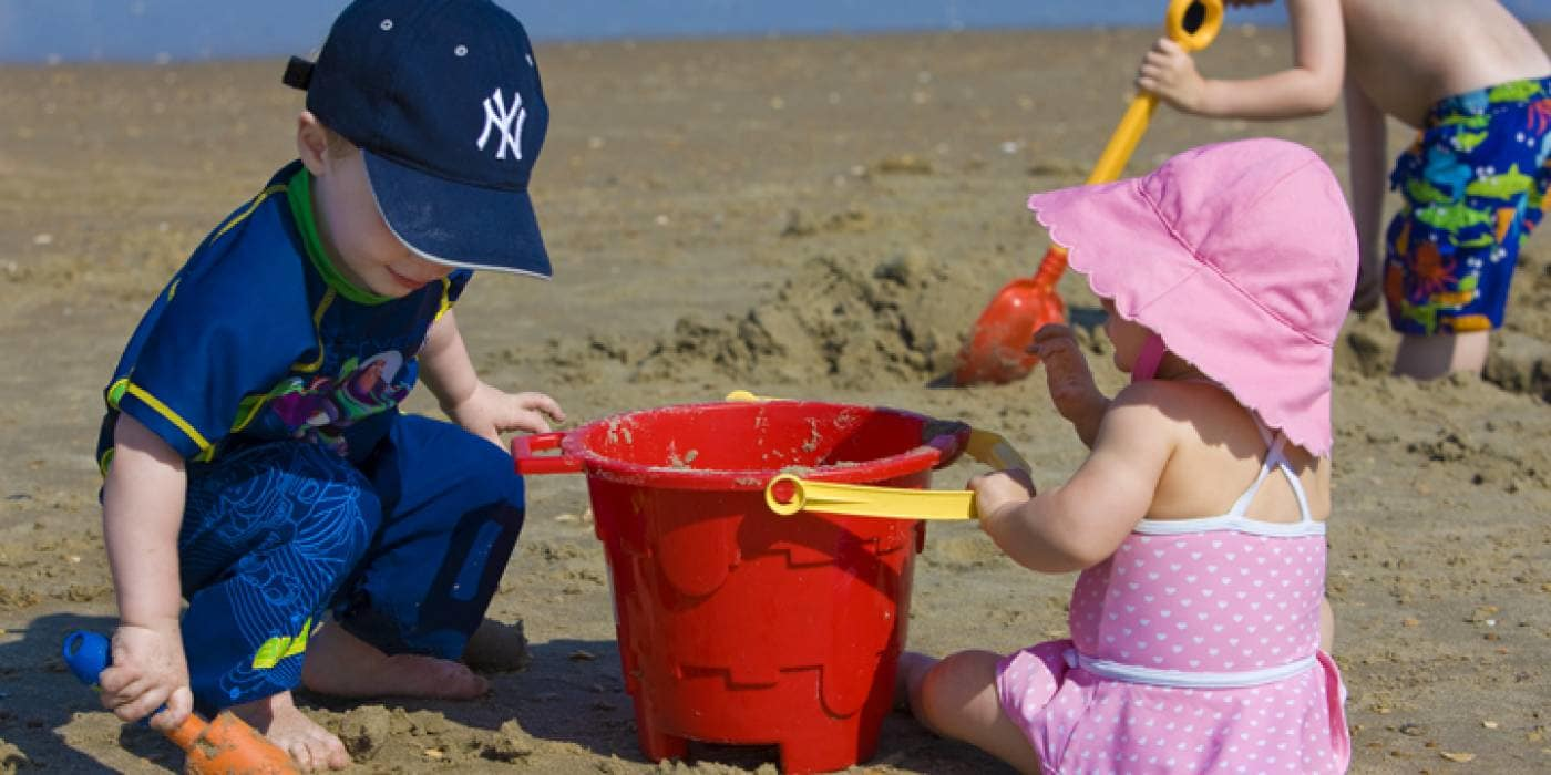 children play on beach in Corolla, NC