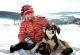 rhoen-schlittenhunde-abenteuer-kind-mit-hund