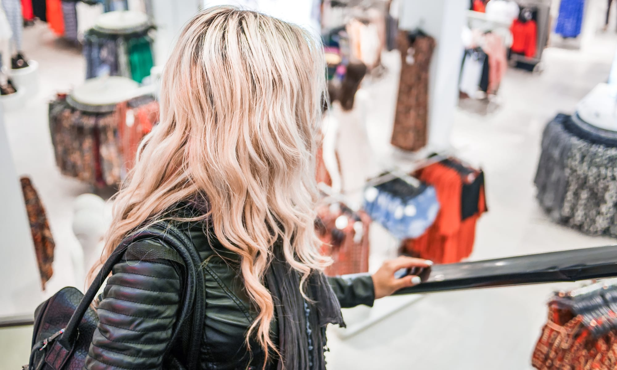blonde woman shopping at a clothing store