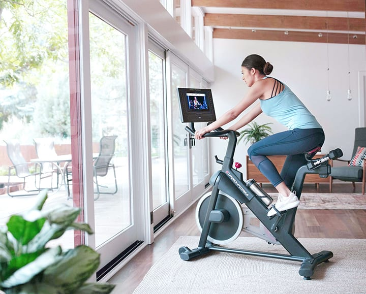 Person riding a exercise bike in their home