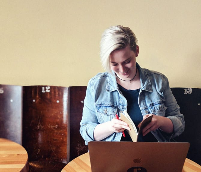 Lacie reading through notes in a coffee shop