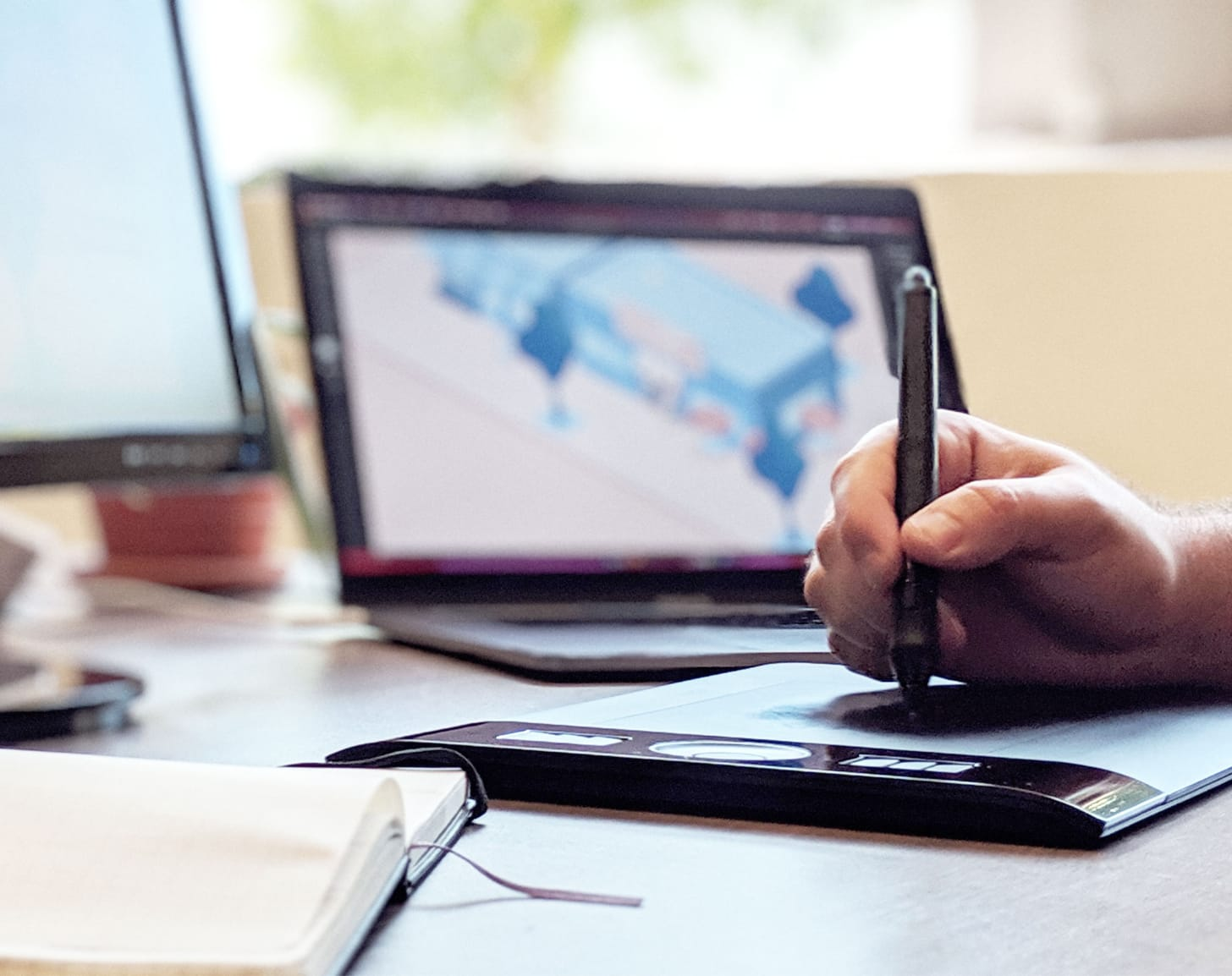Person working on a Wacom tablet