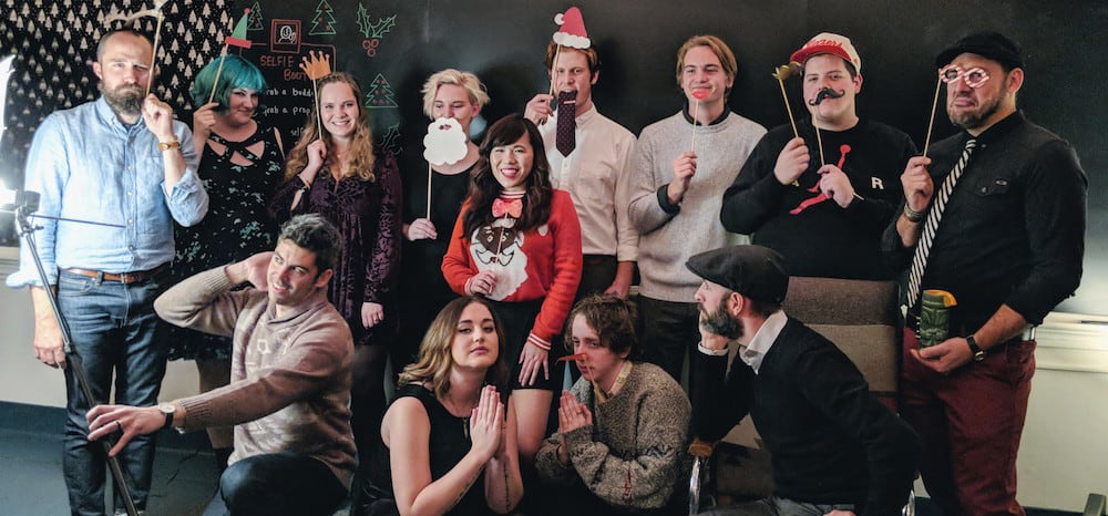 team roboboogie posing for a holiday pic in their Sunday's best