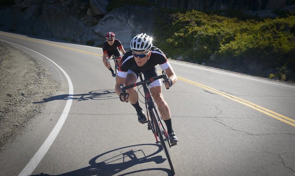 Two people riding Specialized road bikes