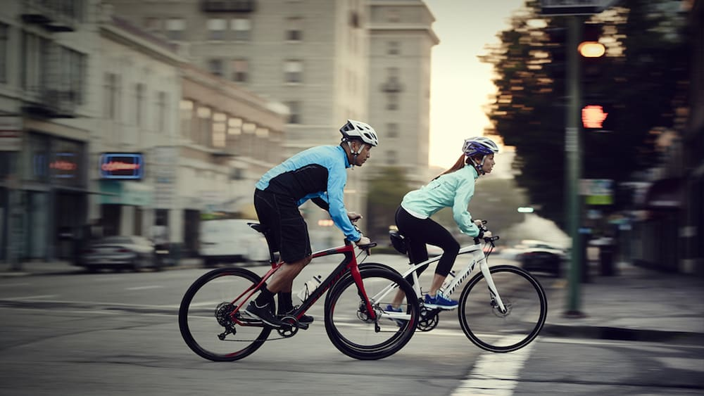 Specialized bike riders in city setting