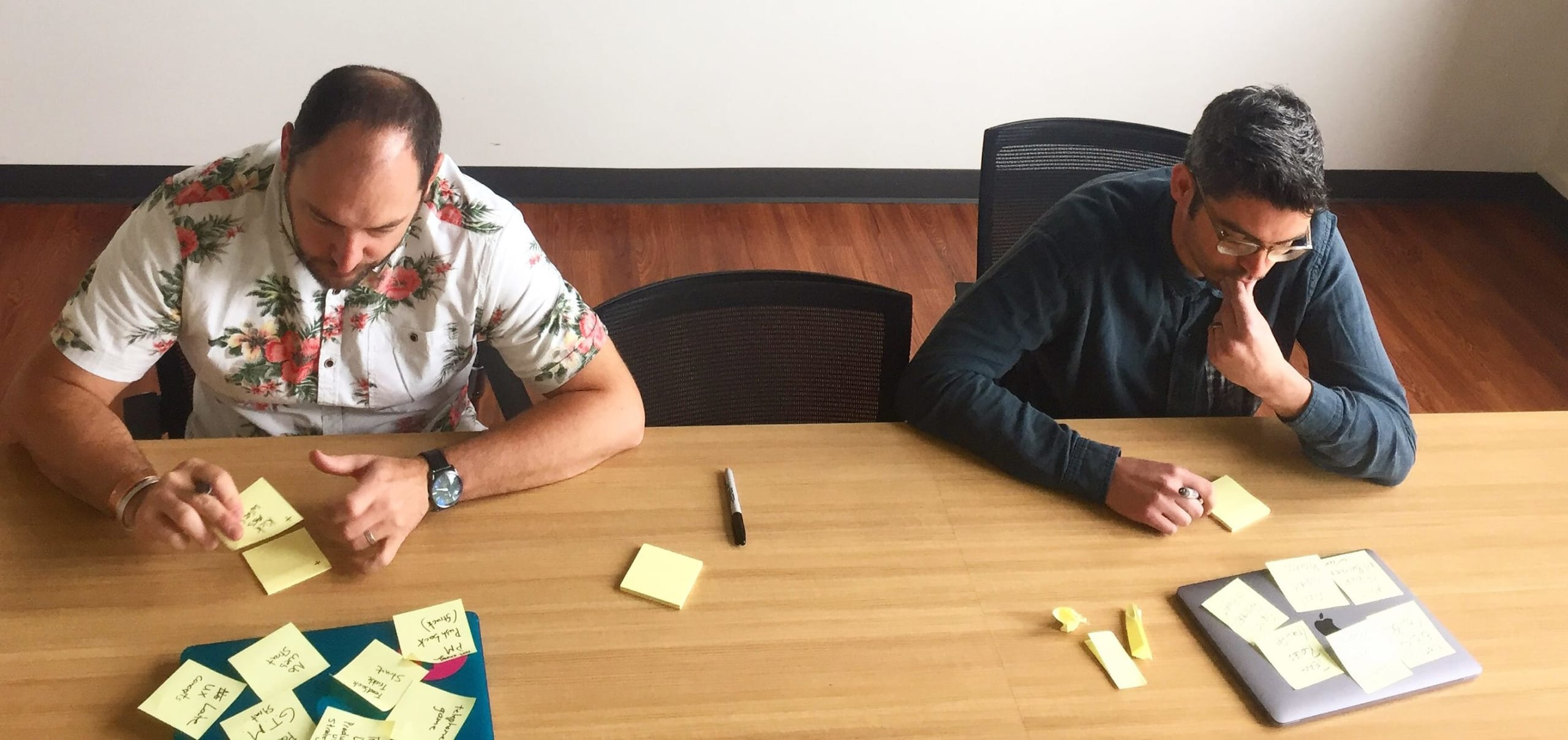 Jed Fugle and John Gentle of roboboogie collaborating in conference room