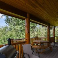 Deck with Traeger Grill and outside dining table