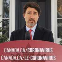 Image of Justin Trudeau on TV with a banner below him with two URLs, canada.ca/coronavirus and canada.ca/le-coronavirus
