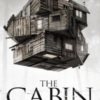 The movie poster for The Cabin In The Woods, which shows a large cabin with sections rotating like a Rubik's Cube