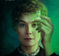 The movie poster for Radioactive (2019) showing Rosamund Pike (as Marie Curie) holding a small vial of Radium with a mushroom cloud inside it