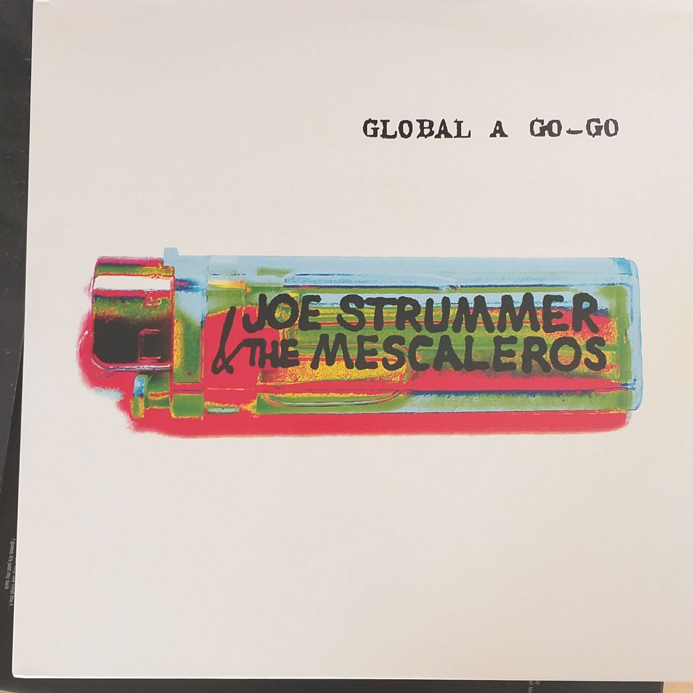 Joe Strummer and the mescaleros Global a go-go LP undefined