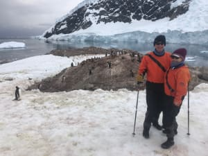 Steve and Ros Bradley in front of a penguin colony