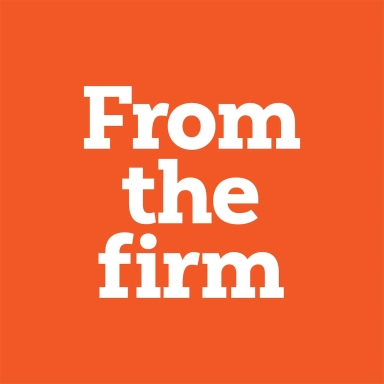 orange background with white text that reads From the firm