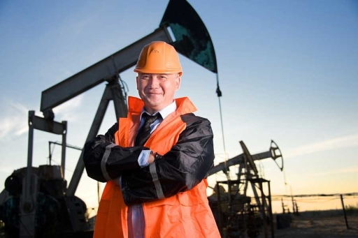 Person standing in front of oil pump
