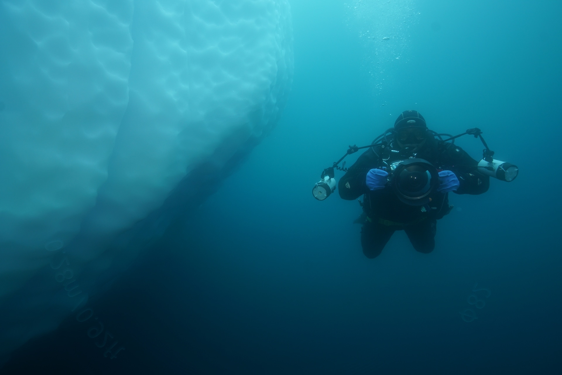 FROM THE FIELD: Dhritiman Mukherjee in full gear: thermals, dry suit, gloves, face mask, air tanks, camera, and strobe lights. In addition, he is also carrying 17 kilos of lead weights on his belt, to counter the additional buoyancy from the gear.
