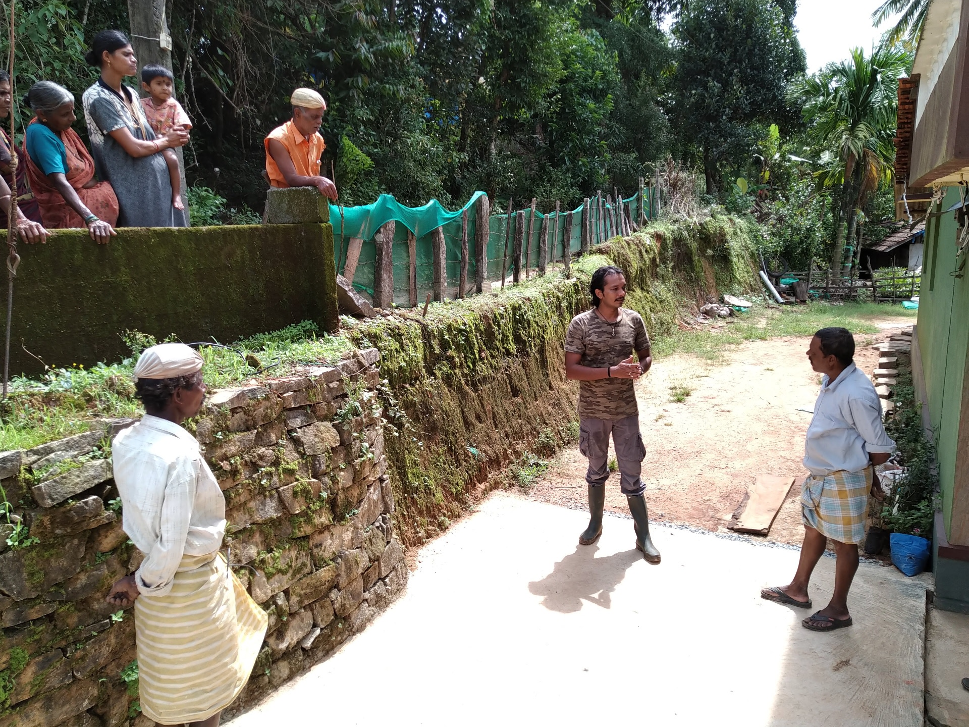 Ajay explains to local people the homing instinct of the king cobra and why it is important to release the snake close to where it is found.  Photo: Nisarg Prakash