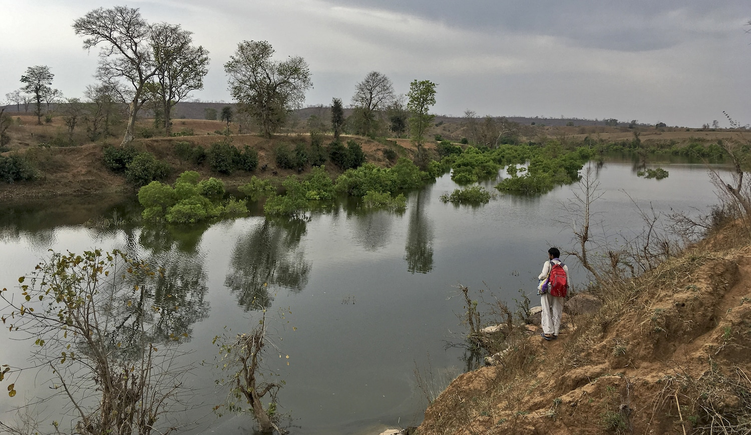 Bhim Rawat from SANDRP (South Asia Network on Dams, Rivers, and People) observing a pool created in the river by an irrigation project. On paper, this irrigation project has no negative social or environmental impact. Reality bears no semblance to these documents.Photo: Siddharth Agarwal