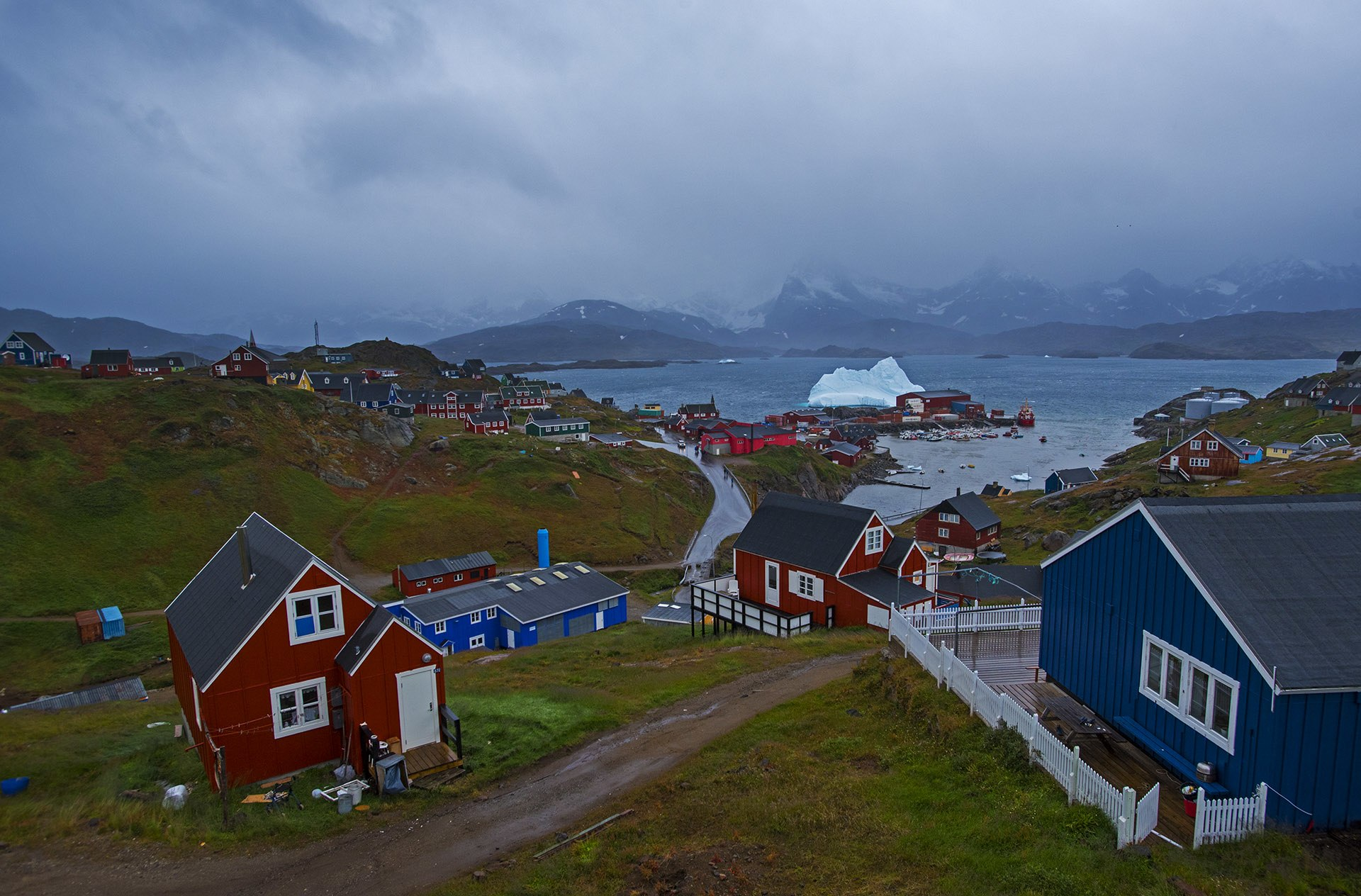 It is not uncommon for the residents of Tasiilaq to walk past icebergs on their daily walk to work. The town is dotted with blue and red homes and gardens where vegetables are grown in the summer months.