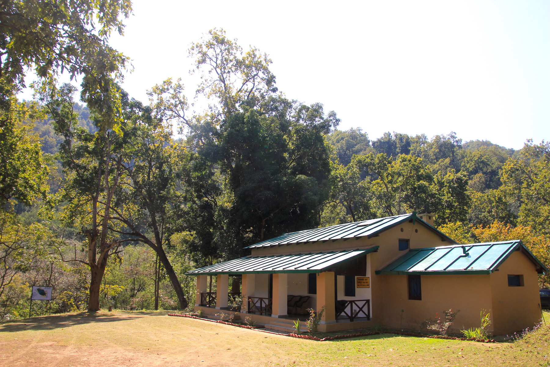 The 117 year old Mundiyapani Forest Rest House in Kalagarh Division. Sitting atop a hillock clearing, overlooking the gurgling perennial Mundiyapani stream and the Mundiyapani forest chowki, the quaint bungalow teleports one into a world long gone. Photo: Raza Kazmi  A cheetal wades through the Palain river, the lifeline of Corbett Tiger Reserve's Kalagarh Division, at Halduparao on a quiet winter morning. Cover photo: Raza Kazmi
