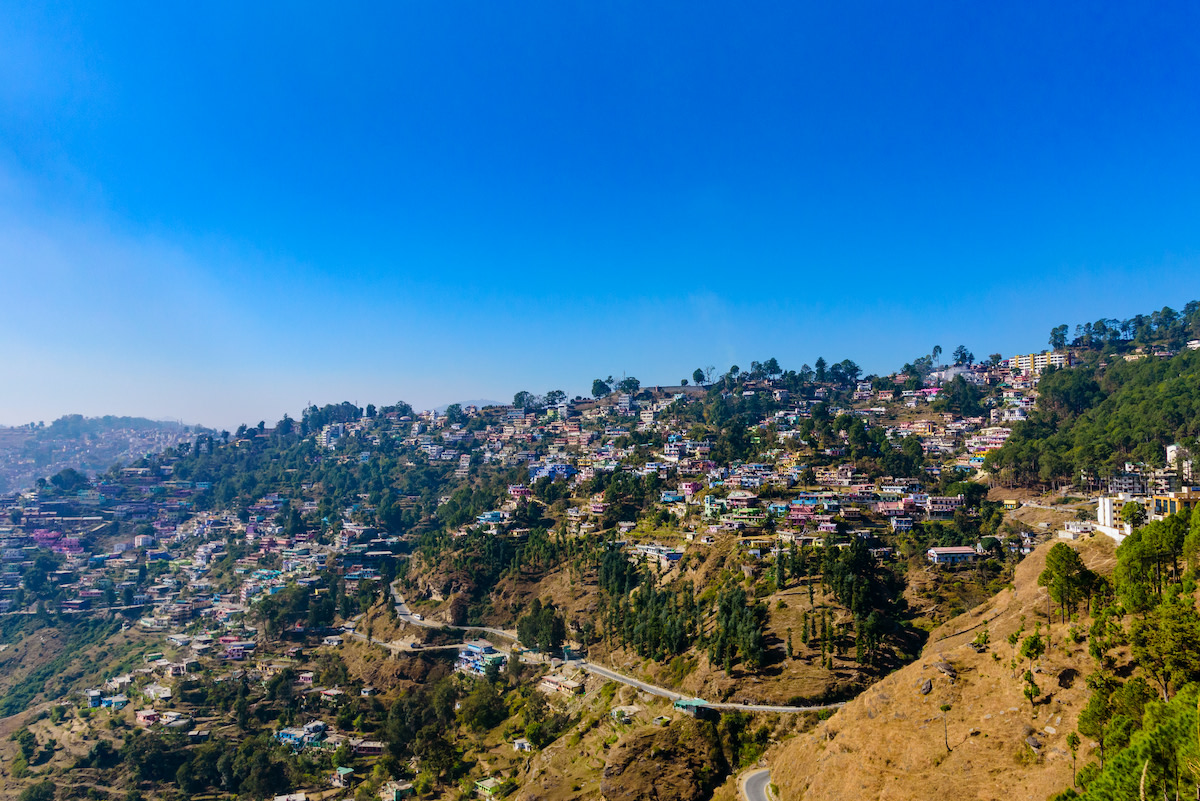 The crowded urban landscape of Almora, Uttarakhand. Growing urban settlements negatively affect oak forest health in the Himalayas as stream water are diverted from forests, there is an increased dependency on fuel wood, and curtailment of surface water flow. Photo: Amit kg/Shutterstock