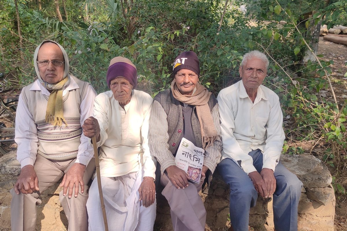 Committee members representing the villages for plantation on the barren mountain. Photo: Gurvinder Singh  Cover photo: The Makino Raghunath Mountain, a once-barren mountain where plantation took place between 1999 and 2002, restoring its greenery.