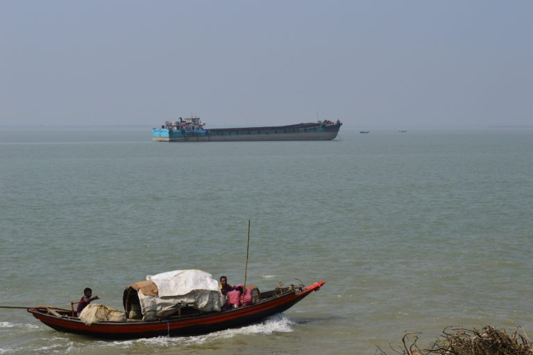 Fishing boat and an anchored empty barge near Namkhana, South 24 Paragnas in West Bengal. Photo: Avli Verma, Manthan Adhyayan Kendra