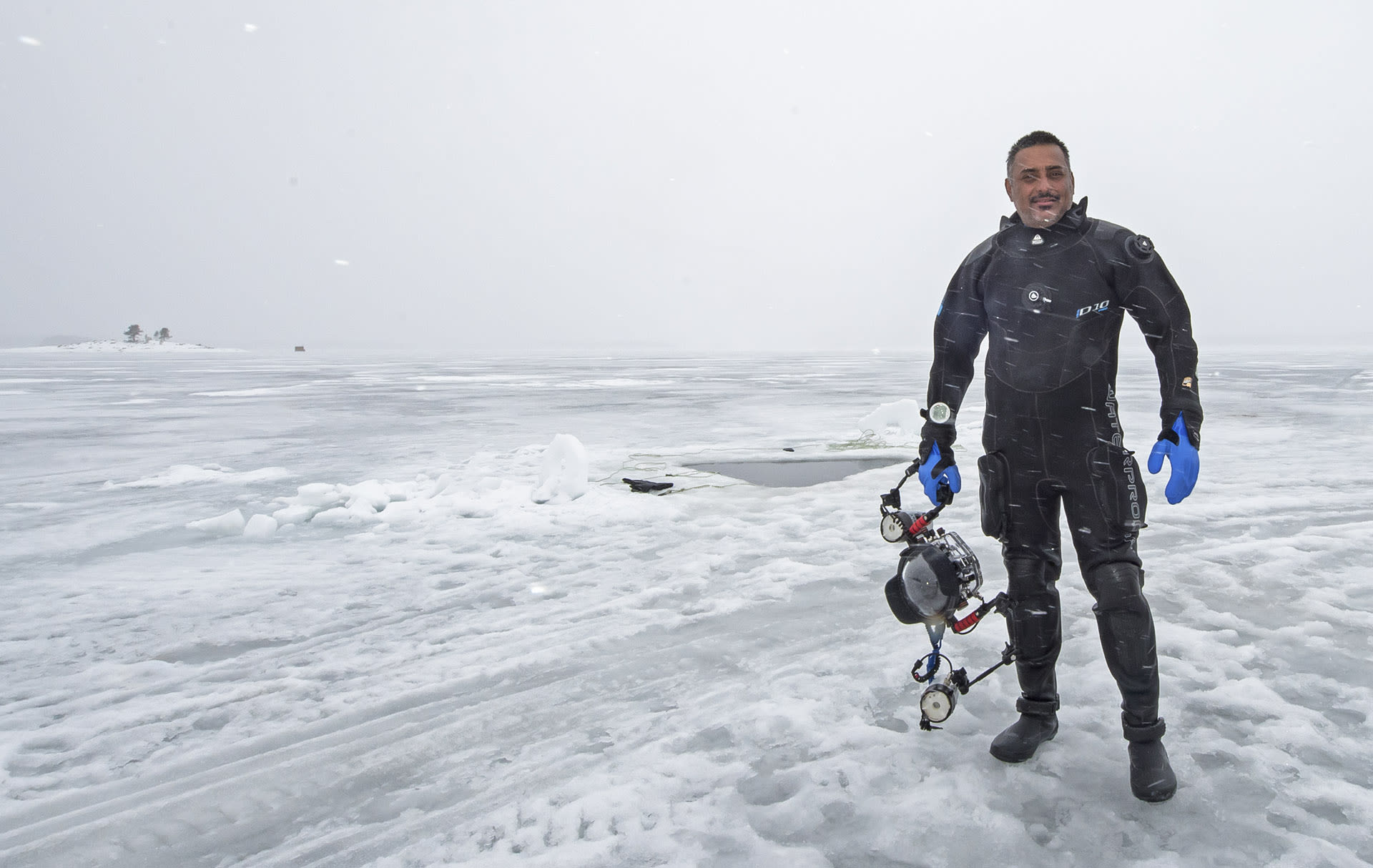Dhritiman after a dive under the frozen White Sea in Arctic Russia