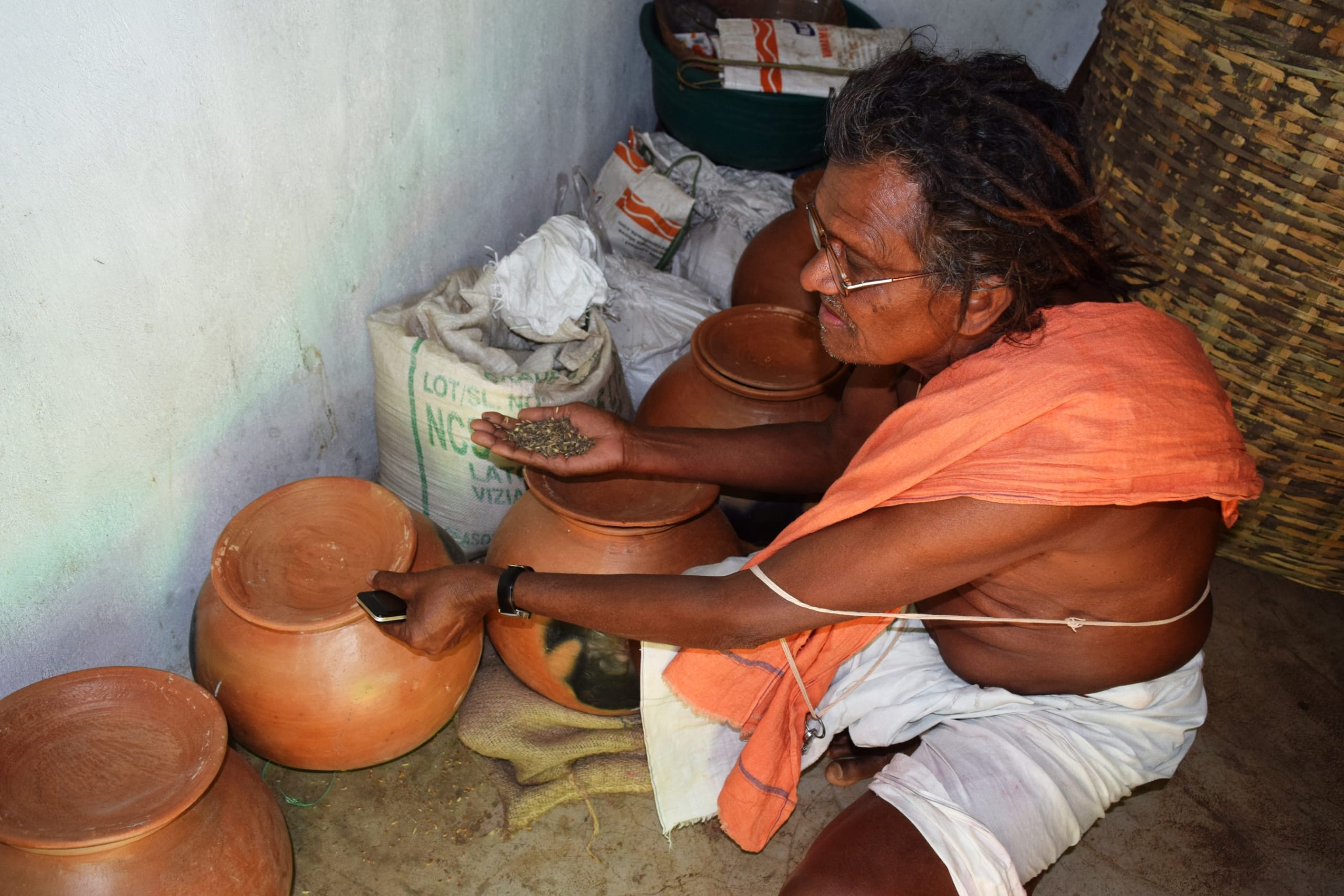 Dambaru Pujari of Padarguda village in the community store of indigenous seeds. Photo: Basudev Mahapatra