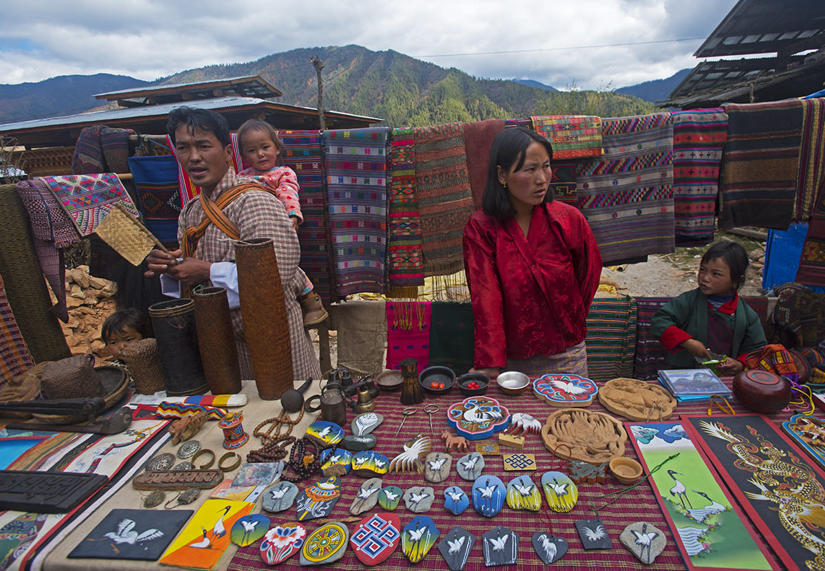Stalls at the festival in Phobjikha brim with colourful paraphernalia: painted stones, scarves, scrolls, shawls, prayer beads, and embroidered patches, all featuring the crane. Hundreds of Bhutanese travel great distances to attend the event. Among the more popular events are the masked dance performances by resident monks.
