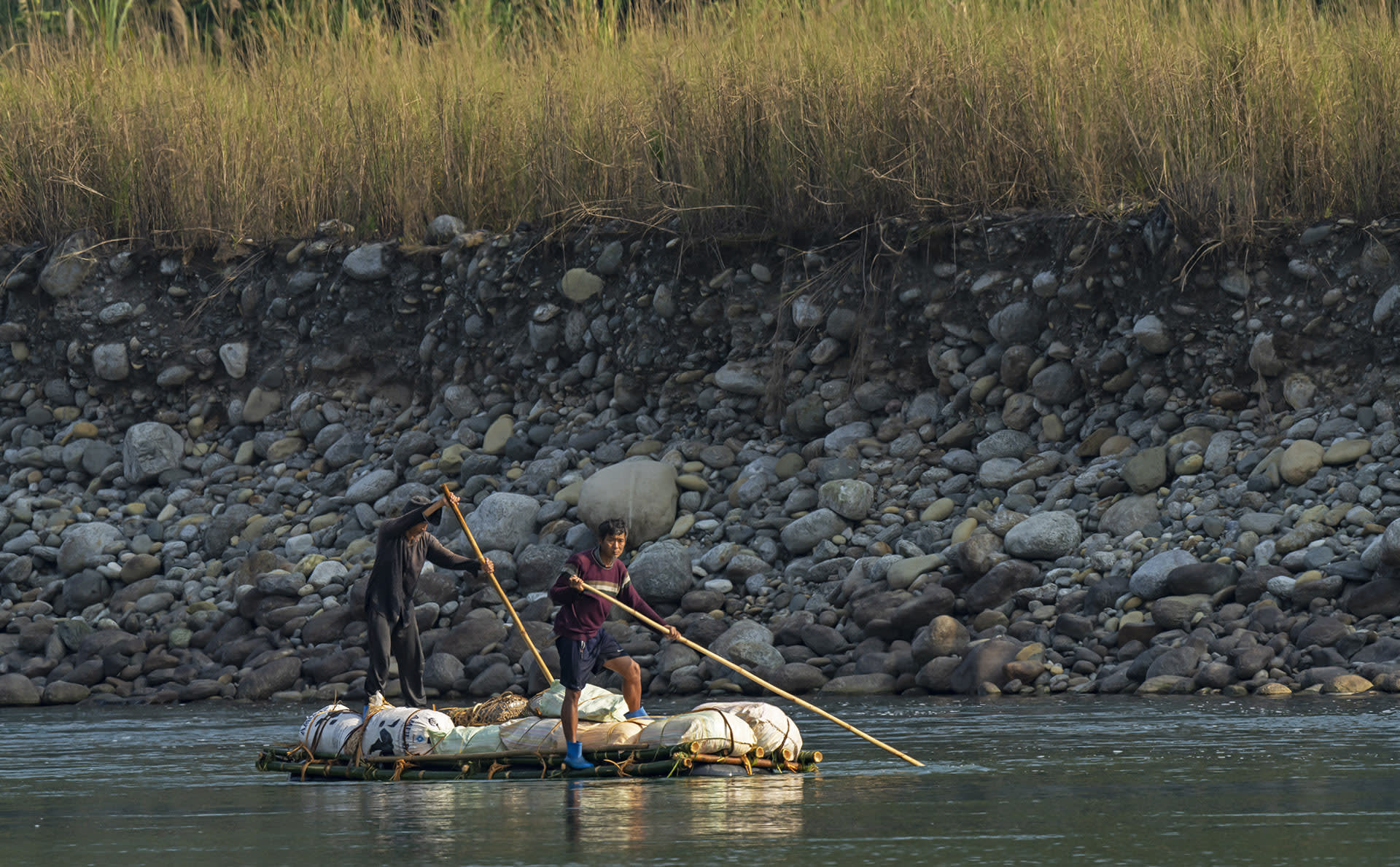 "In the absence of any infrastructure, locals from Vijoynagar either walk or use the river to transport goods to Miao. Sometimes, they build rafts from bamboo that grows abundantly in the area and move along the boulder-strewn riverbank until they arrive at their destination.  In 2013, the government proposed plans for a two-lane road connecting Vijoynagar with Miao, but the project did not progress, ""as ecologists flagged the road as a bad idea for Namdapha, which is a meeting point of Himalayan, Indo-Burmese, and Indo-Chinese flora and fauna,"" according to a report by journalist Rahul Karmakar in the The Hindu."