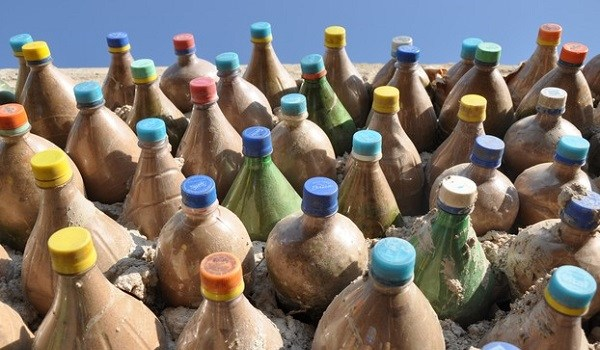 """Instead of choking the oceans, these bottles have become """"bricks"""" that can build a dream house. Photo: My Africa Now"""
