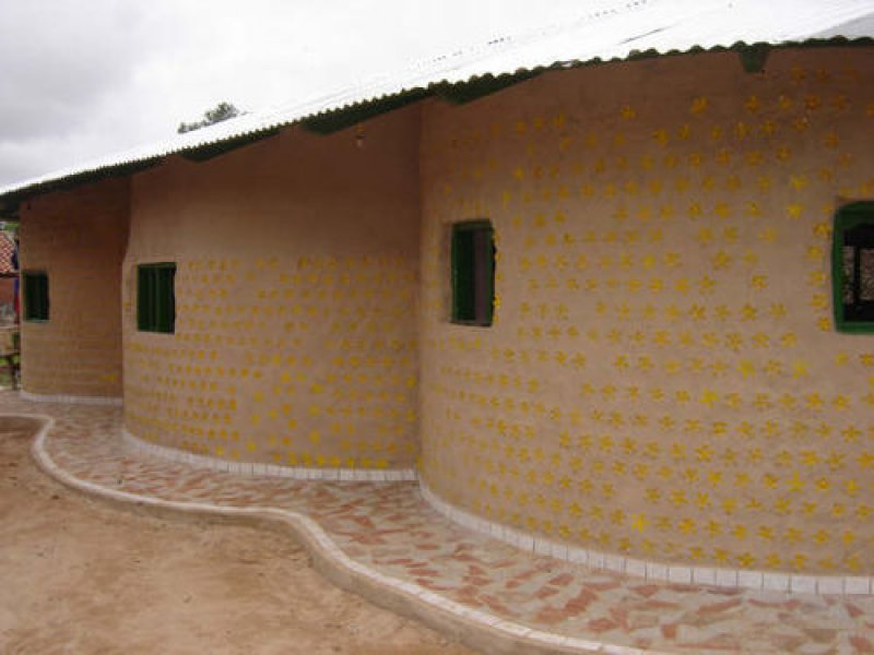 Beautiful bottle-brick homes in Nigeria not only reuse waste, they provide homes to the needy. Photo courtesy: Buzz in Nigeria