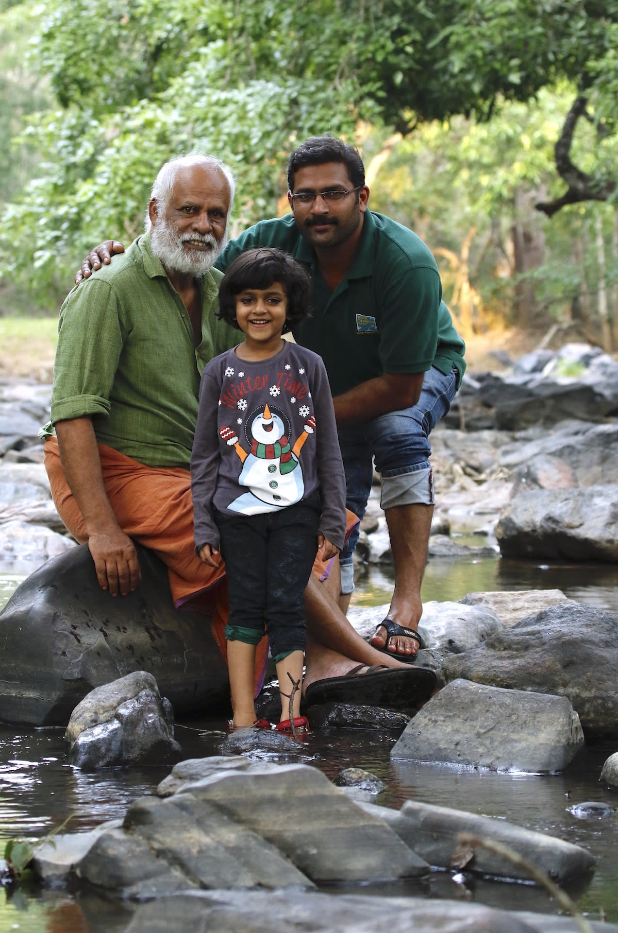 badusha with son and granddaughter in the forest