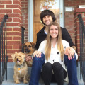 A loving couple with two fur babies dog boarding & pet sitting