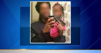 Police investigating Facebook photo of toddler holding gun