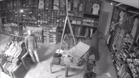 Watch bumbling burglar falls through store's ceiling twice